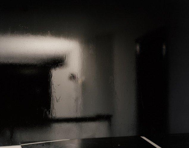 Pernille Koldbech Fich: Black [table, board, light], 2009-2011, 112 x 142 cm.
