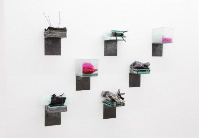 Anita Jørgensen  N.Y. Luggage  2012. Jern, bly, glas papir, gummi, plastik, hver 30x15x15 cm. Foto: Eva Merz.