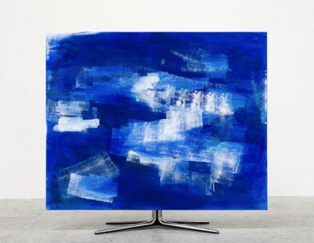 Torben Ribe: Untitled (no signal), 2012. Akryl og cornflakes på lærred, tv-fod, 3D plakat. 100 x 90 x 25 cm.
