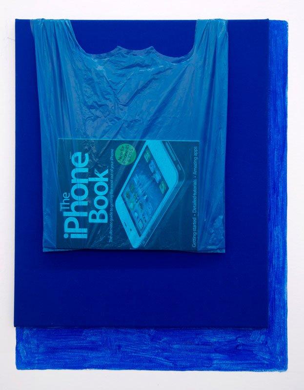 Torben Ribe: Layers of Blue, 2012.  Plastikpose, iPhone magazine, bomuld og acrylmaling på væg.  69 x 54 cm.