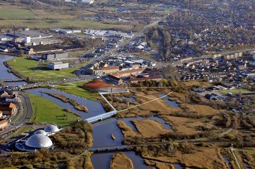 Den nye museumsbygning fylder godt i landskabet, når man kommer fra syd. Fotomanipulation fra 3xN.