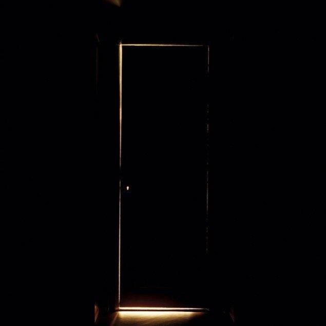 Daylight lamp placed behind library door, Jakob Hunosøe, 2010.