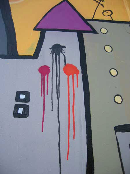Tagget i byen på væggen i byen. En fantasi-by har da også graffiti.