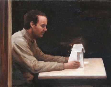 En model funderer over sin egen lille papir-model. Peter Martensen, Model. Foto: Henrik Petit