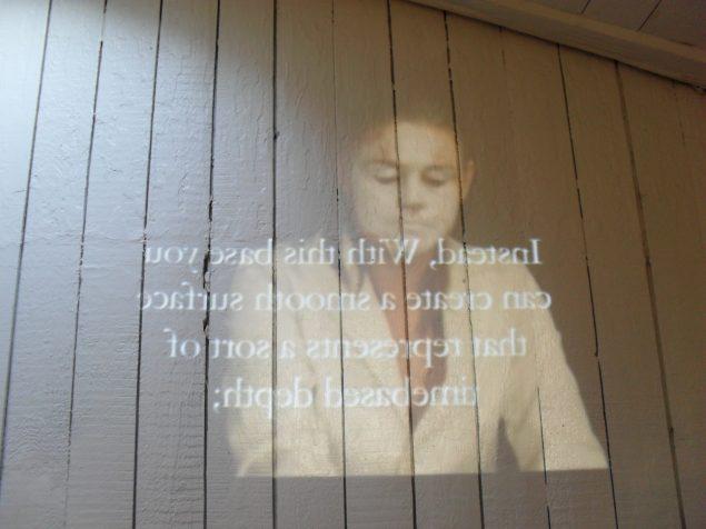 Beauty - within and without, 2012. Spejlvendt video-guide om at pynte sig selv og pynte på sandheden. Vist på toilettet på Den Frie Udstilingsbygning. Foto. Ulla Hvejsel
